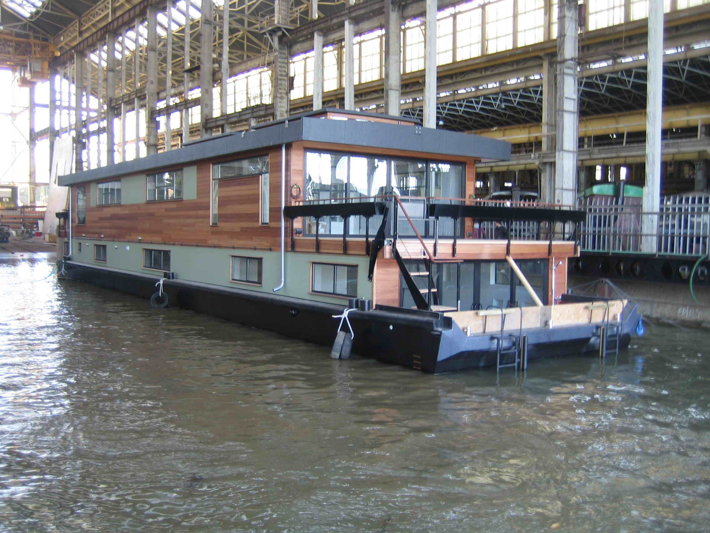 Houseboats by dirkmarine all custom designed steel for How to build a floating house